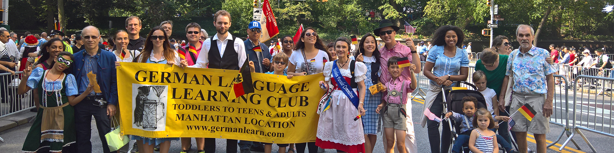 Club Members Displaying German Language Learning Club Banner